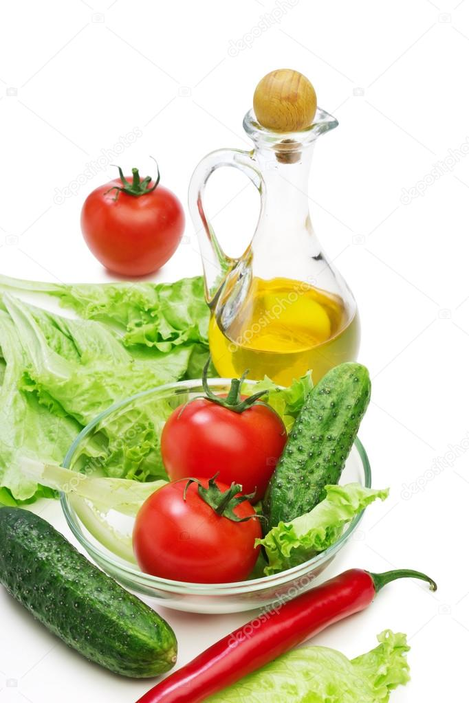 Set vegetable and jug of vegetable oil isolated on the white background  — Stock Photo #13419289