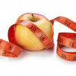Stock Photo: Measure tape and apple isolated