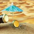 Funny bottle cork on a sandy beach — Stock Photo #13555331