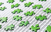 Green puzzles and binary code — Stock Photo