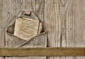 Vintage paper page and notes on a wooden boards — Stock Photo