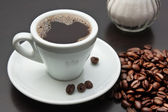 Pile of coffee beans and a cup — Stock Photo