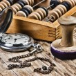 Pocket watch, abacus and stamp — Stock Photo
