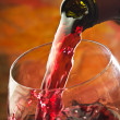 Red wine being poured into wine glass — Stock Photo #13849471