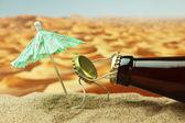 Funny bottle cork on a sandy beach — Stock Photo