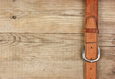 Vintage belt buckle on a old wooden board — Stock fotografie