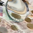 Magnifying glass on a pile of old European money — Stock Photo #13877952