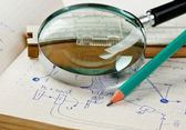 Magnifying glass and a slide rule on the old page with the calcu — Stock Photo
