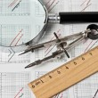 Engineering tools on technical drawing — Stock Photo #13915699