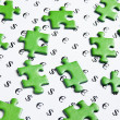 Green puzzles and symbols of money - Stock Photo
