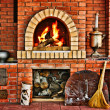 Russian interior kitchen with an oven and a burning fire — Stock Photo #14366319