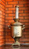 Old brass samovar on a brick kitchen — Stock Photo