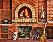 Russian interior kitchen with an oven and a burning fire — Stockfoto