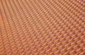 Terracotta metal tile roof, background — Stock Photo