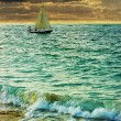 Sailing boat on a sunset — Stock Photo