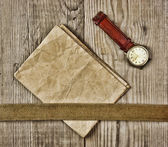Vintage paper and old broken watch on wooden boards — Stock Photo