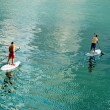 Two surfer in calm water - Stock Photo