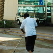 Janitor cleans the sidewalk - Stock Photo