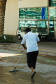 Janitor cleans the sidewalk — Stock Photo