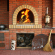 Russian interior kitchen with an oven and a burning fire - Foto Stock