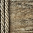 Old rope on a wooden background - Stock Photo