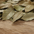 Dry bay leaf on old wooden board — Stock Photo #18372241