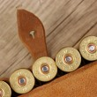 Old hunting cartridges and bandoleer on a wooden table - ストック写真
