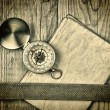 Stock Photo: Vintage paper with compass on old wooden boards