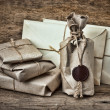 Pile parcel wrapped with brown kraft paper — Stock Photo