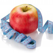Blue measure tape and red apple isolated — Stock Photo #18587085