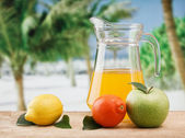 Variety of fruit and juice on a wooden table in the garden — Stock Photo
