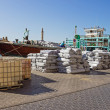 Loading a ship in Port Said in Dubai - Stock Photo