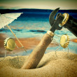 Funny bottle cork on a sandy beach - Stockfoto