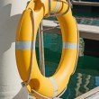 Yellow life buoy on the sea pier — Stock Photo
