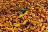 Fried silkworms at night market Thailand — Stock Photo