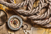Compass and rope on map — Stockfoto