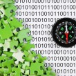 Puzzles and compass on a binary code - Photo