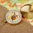Compass on the map with sand — Stock Photo