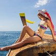 Young girl in bikini sitting on Thai Longtail boat — Stock Photo #22018175