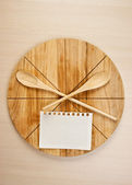Stylized clock - cutting board and wooden spoons — Stock Photo