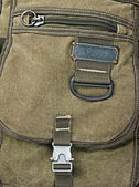 Buckle on the old green backpack — Stock Photo
