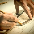 Hand draws a pencil on drawing — Stock Photo #22192249