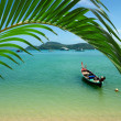 Lonely boat on beach of tropical island — Stock Photo
