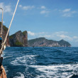 Traditional Thai Longtail boat and island of Phi Phi Leh on the - Stock Photo