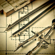 Stock Photo: Engineering tools on technical drawing