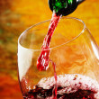 Red wine being poured into wine glass — Stock Photo #22779000
