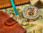 Compass wallet and passport on the old map — Stock Photo