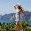 Girl at the resort in a dress on the background of the bays of t — Stock Photo #22898068