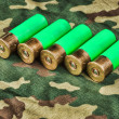Old hunting cartridges on camouflage background — Stockfoto