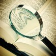 Stock Photo: Books and magnifying glass